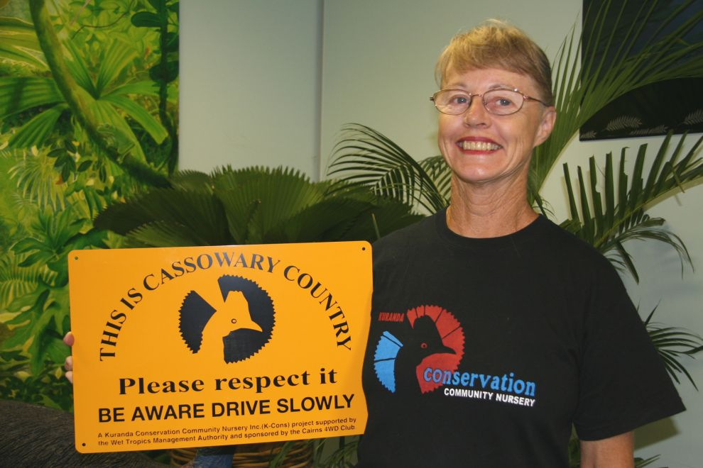 Jax Bergersen (Kuranda Conservation) with her cassowary sign - December 2007 Photographer: WTMA